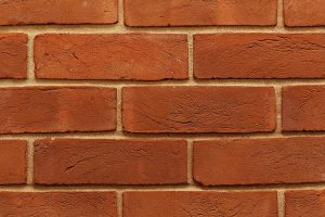 Close-up ow wall made from Red Rubber bricks